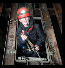 school child on a mine exploration trip